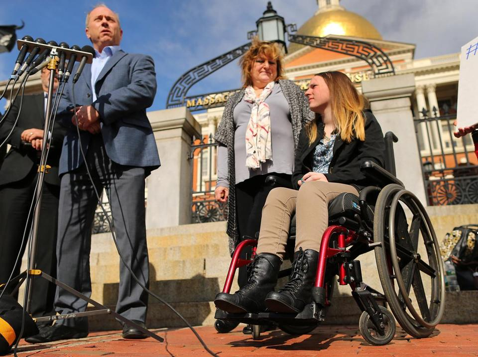 Justina Pelletier (right) and her parents met with the media in front of the State House Thursday.